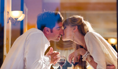 Couple renegotiating their sex contrtact at dinner